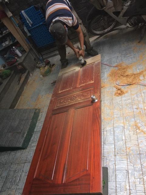sửa cửa gỗ cong vênh tphcm